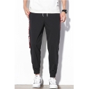 Men's Stylish Letter Printed Tape Patched Drawstring Waist Elastic Cuffs Casual Cotton Tapered Pants