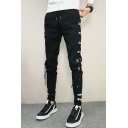 Men's Stylish Letter Printed Crisscross Side Design Drawstring Waist Black Casual Pencil Pants