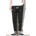 Fashion Logo Embroidery Pattern Drawstring Waist Elastic Cuffs Men's Casual Tapered Pants