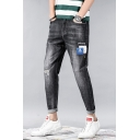 Men's Cool Fashion Washed-Denim Skull Patched Black Ripped Ripped Jeans