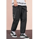 Men's Cool Fashion Letter Printed Flap Pocket Drawstring Cuffs Black Casual Thin Skateboard Pants