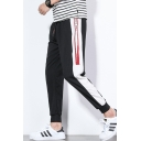 Guys Trendy Colorblock Stripe Side Letter Printed Drawstring Waist Casual Thin Tapered Pants