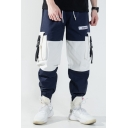 Men's Stylish Colorblocked Patched Buckle Strap Flap Pocket Side Elastic Cuffs Hip Pop Casual Loose Drawstring Waist Cargo Pants