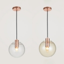 Amber/Clear Glass Spherical Mini Pendant Post Modern 1 Light Hanging Lamp in Copper Finish