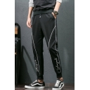 Men's New Fashion Contrast Line Letter Pattern Drawstring Waist Black Casual Tapered Pants