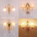 Metal Engraved Arm Wall Light with Crystal 2 Heads Luxurious Sconce Light in Gold for Bedroom
