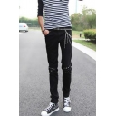 Men's Trendy Solid Color Chain Rivet Embellished Black Ripped Pencil Pants