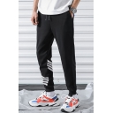 Guys Trendy Contrast Stripe Printed Drawstring Waist Black Cotton Relaxed Tapered Pants