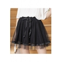 Trendy Black Elastic Waist Bow Front Patch Pleated Mini Flared Mesh Skirt