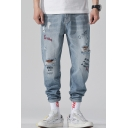 Men's Street Trendy Letter Printed Cool Damage Light Blue Ripped Jeans