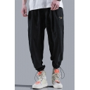 Hot Fashion Letter Label Patch Loose Fit Drawstring Gathered Cuffs Trendy Track Pants for Guys