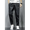 Men's Simple Fashion Letter Label Patch Drawstring Waist Elastic Cuffs Casual Tapered Pants
