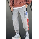 New Fashion Colorblock Patched Side Flap Pocket Drawstring Waist Loose Fit Elastic Cuffs Sports Cargo Pants for Men