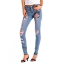 Womens Fashion Mid Waist Floral Embroidery Print Distressed Busted Knees Light Wash Skinny Jeans