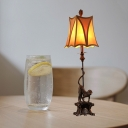 Traditional Trapezoid Table Lighting with Monkey 1 Light Beige Fabric Shade Table Lamp in Bronze