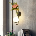Spherical Wall Sconce Minimalism 1 Light Wall Lamp with Clear Urn Glass Lampshade and Flower Decoration in Black Finish