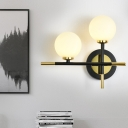 Milk Glass Orb Sconce Light with Cross Design 2 Lights Modern Black and Brass Wall Light