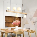 Wood Pipe Island Lighting Asian 5/7 Heads Hanging Pendant Light in Beige with Bubble White Glass Shade