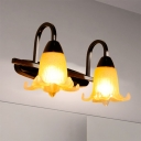 Modern Floral Vanity Light Fixture Amber Glass 2 Heads Kitchen Wall Mounted Lighting with Gooseneck Arm in Black