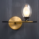 Minimalist Clear/Amber Glass Egg Light Fixture 1 Light Brass Wall Sconce with Horizontal Arm