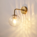 Golden Spherical Wall Lamp Minimalist 1 Light Rippled Glass Wall Sconce Lighting with Arm