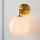 Post-Modern Single Sconce Light Metal Brass Finish Curvy Arm Wall Sconce with Clear/White Glass Orb Shade