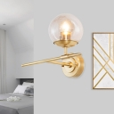 Globe Hand Blown Glass Wall Light Contemporary 1 Light Brass Sconce Light with Crossed Arm