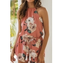 Pretty Girls Sleeveless Crew Neck Bow Tied All-Over Floral Cut Out Back Relaxed Romper in Pink