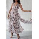 Amazing White Sleeveless Surplice Neck All Over Floarl Printed Tied Waist Pleated Maxi Flowy Dress for Women
