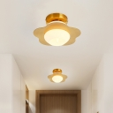 Cream Glass Sphere Flush Light Fixture Modernist 1-Bulb Gold Flush Mount with Flower Metal Panel Detail