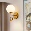 Modernism Ball Wall Sconce Cream Glass 1-Light Bedside Wall Mount Lamp Fixture in Brass