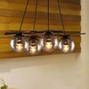 Black 4 Lights Pendant Light Antiqued Amber Glass Ball Ceiling Chandelier with Sputnik Slim Iron Bar Deco