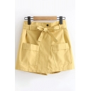 Pretty Ladies Solid Color Bow Tie Waist Pockets Panel Asymmetric Relaxed Fit Shorts