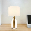 Drum Night Light Modernism Fabric 1-Head Bedroom Table Lighting in White with Clear Glass Base
