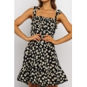 Boutique Ladies Sleeveless Bow Tie Shoulder All Over Flower Pattern Ruffled Trim Short Pleated A-Line Cami Dress in Black