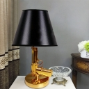 Black Tapered Table Light Modernism 1-Bulb Fabric Nightstand Lamp with Resin Gun-Shaped Design