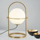 Postmodern Spherical Table Lighting Ivory Glass 1 Light Bedroom Night Lamp in Gold with Metal Frame
