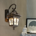 Rustic Lantern Wall Mount Light 1-Light Metal Sconce in Black/Brass with Water Glass Shade