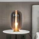 1 Head Bedroom Night Lamp Contemporary Gold Nightstand Light with Oval Smoke Gray Glass Shade