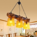 Yellow Rippled Glass Brown Island Lighting Trapezoid 3-Light Countryside Pendant Light Fixture with Linear Bamboo Beam