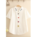 Preppy Girls Short Sleeve Peter Pan Collar Japanese Letter Cartoon Embroidery Curved Hem Relaxed Shirt in White