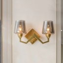 Postmodern Curving Arm Wall Light Metal 2 Heads Living Room Sconce Lighting in Brass with Cone Clear/Smoke Glass Lampshade