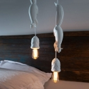 Single Head Pendulum Light Rural Squirrel Chasing After Pinecone Resin Down Lighting Pendant in Pink/White/Blue