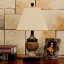 Single-Bulb Night Lamp Lodge Pyramid Fabric Table Light in Beige with Pinecone Detail