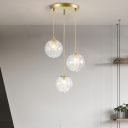 Clear Glass Pumpkin Ball Cluster Pendant Light Minimalist 3 Heads Suspension Lamp in Gold with Metal Line Deco Inside