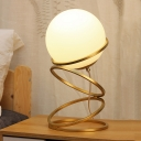 Loop Night Table Light Postmodern Metallic 1-Light Bedside Night Lamp in Gold with Orb Cream Glass Shade