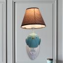 Bird Shape Resin Wall Light Fixture Cartoon 1 Head Pink/Blue Sconce Lamp with Barrel Brown Fabric Shade