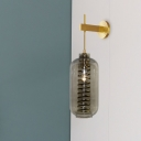 Postmodern Oblong Smoke Glass Wall Lamp 1 Bulb Sconce Lighting Fixture in Brass with Coiled Metal Guard Inside