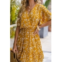 Pretty Ladies Yellow Short Sleeve Surplice Neck All Over Floral Printed Ruffled Trim Short Pleated A-Line Dress