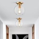 Minimalist Globe Ceiling Light Clear Open Glass 1 Head Passage Flush Mount Fixture in Brass